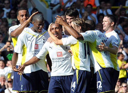Tottenham players celebrate with Benoît Assou-Ekotto after scoring on the opening day of the season
