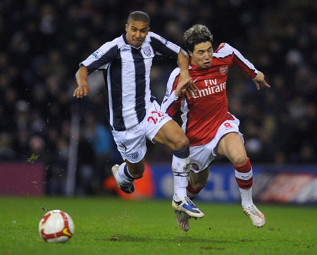 West Brom's Gianni Zuiverloon fights Arsenal's Samir Nasri for the ball during the 2008-09 season