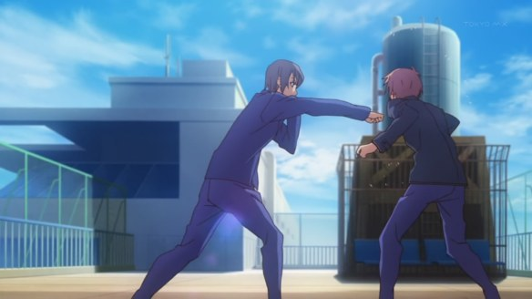 Jin delivers a right hook to Sorata's chin