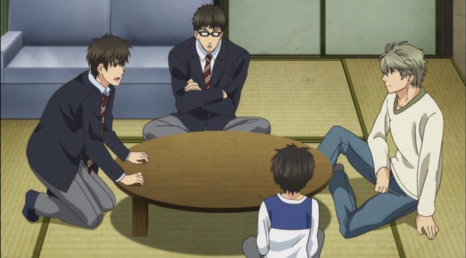 Aki, Shima, Haru and Ren talk around a table in Haru's apartment.